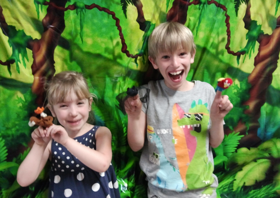Children with 'Monkey Puzzle' finger-puppets