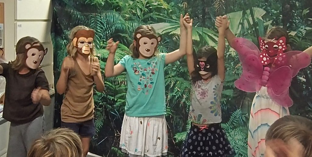 Monkey Puzzle children's performance, all wearing animal masks