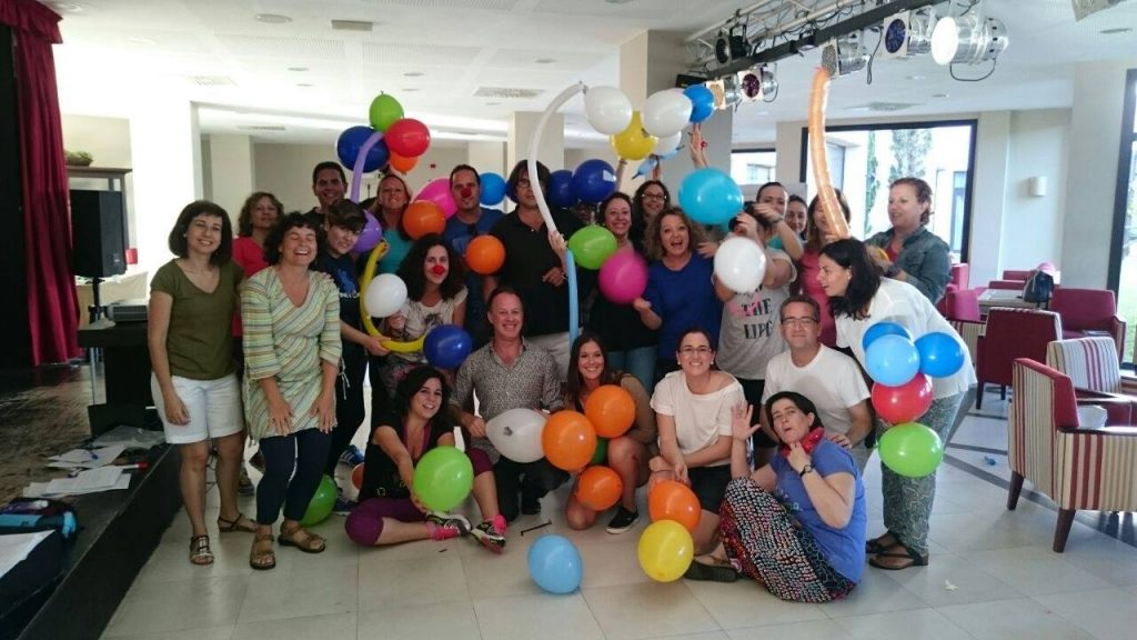 John Harrop & teachers playing with balloons