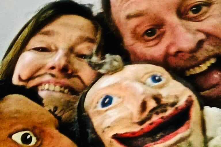 Bat-i-Burrillo actors with puppets; close-up of four faces