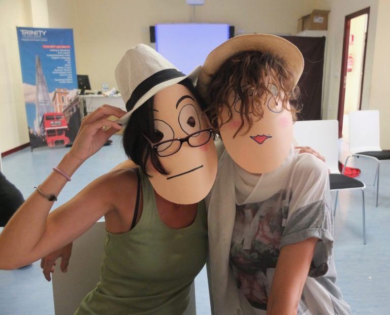 Teachers in paper character masks made in the workshop