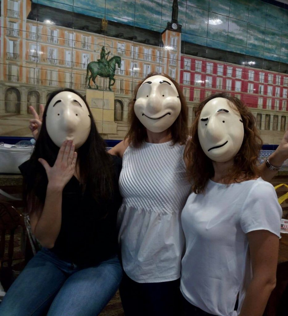 Teachers posing in Trestle theatre's Larva masks