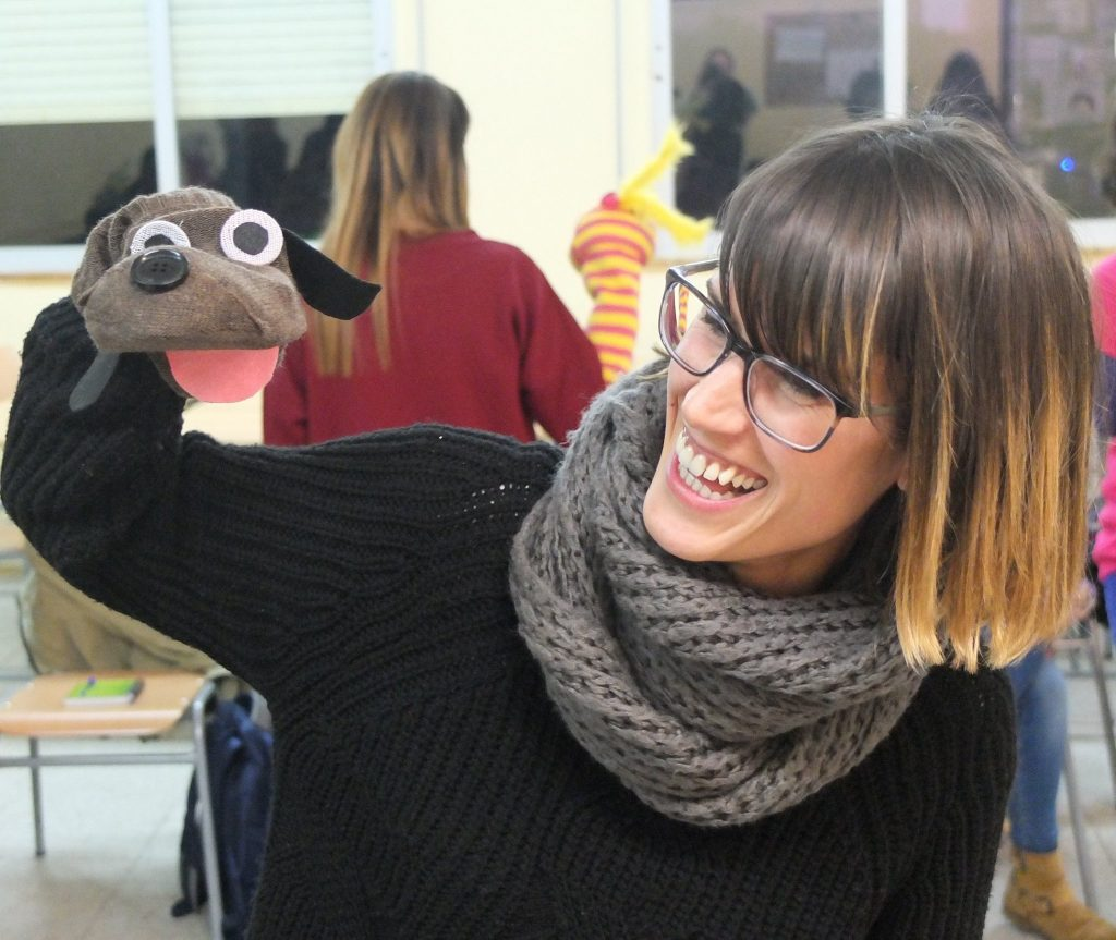 Teacher demonstrating her sock puppet for infants